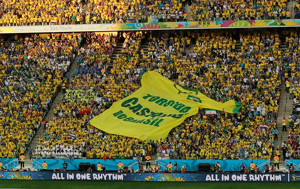 A giant shirt 'Castilho do Brasil Fan Club' is displayed during the group A World Cup soccer match between Brazil and Croatia, the opening game of the tournament, in the Itaquerao Stadium in Sao Paulo, Brazil.
