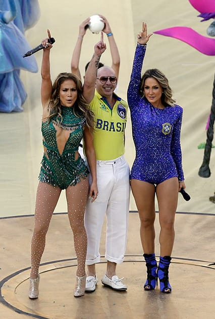 US singer Jennifer Lopez, left, Brazilian singer Claudia Leitte and rapper Pitbull perform during the opening ceremony ahead of the group A World Cup soccer match between Brazil and Croatia, the opening game of the tournament, in the Itaquerao Stadium in Sao Paulo.