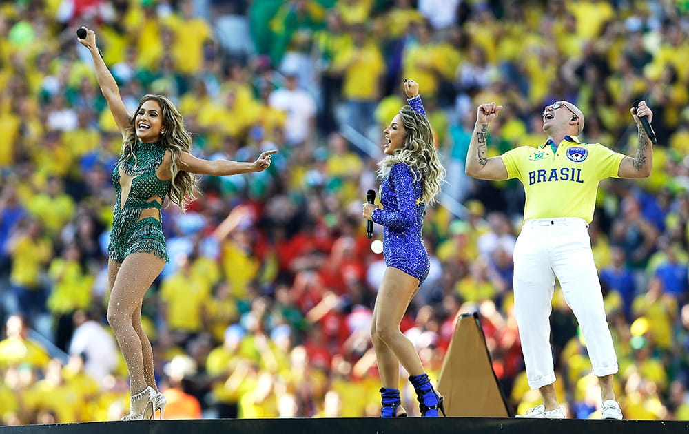 US singer Jennifer Lopez, rapper Pitbull and Brazilian singer Claudia Leitte perform during the opening ceremony ahead of the group A World Cup soccer match between Brazil and Croatia, the opening game of the tournament, in the Itaquerao Stadium in Sao Paulo, Brazil,