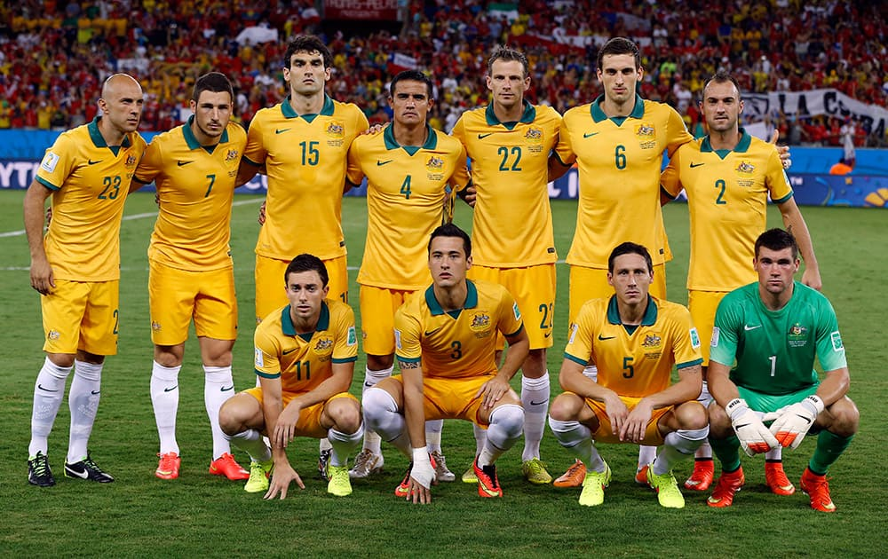 The Australian team poses for a photo before the group B World Cup soccer match between Chile and Australia in the Arena Pantanal in Cuiaba, Brazil.