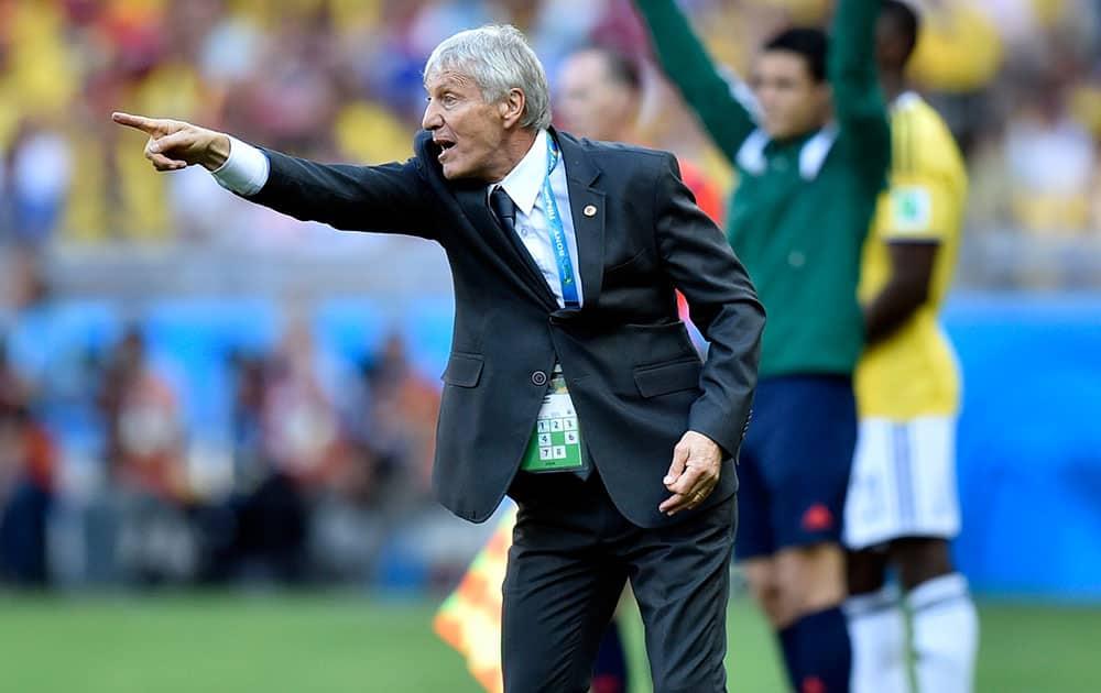 Colombia's head coach Jose Pekerman yells from the sideline during the group C World Cup soccer match between Colombia and Greece at the Mineirao Stadium in Belo Horizonte, Brazil.