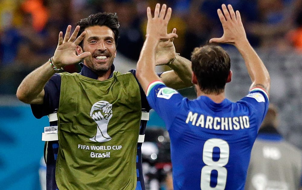 Italy's goalkeeper Gianluigi Buffon, left, celebrates with Claudio Marchisio after the group D World Cup soccer match between England and Italy at the Arena da Amazonia in Manaus, Brazil.