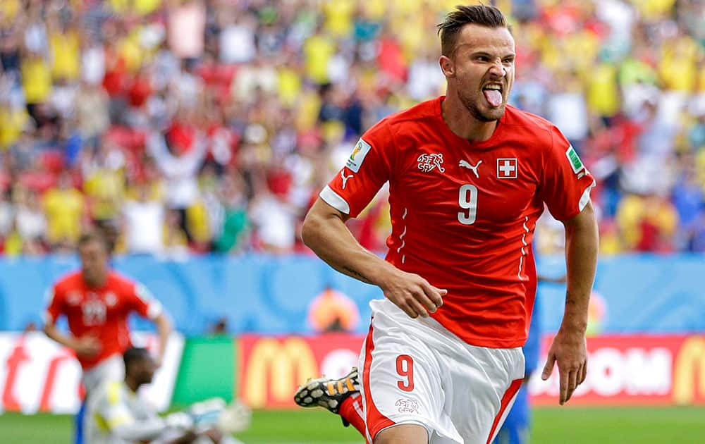 Switzerland's Haris Seferovic scores his side's second goal during the group E World Cup soccer match between Switzerland and Ecuador at the Estadio Nacional in Brasilia, Brazil.