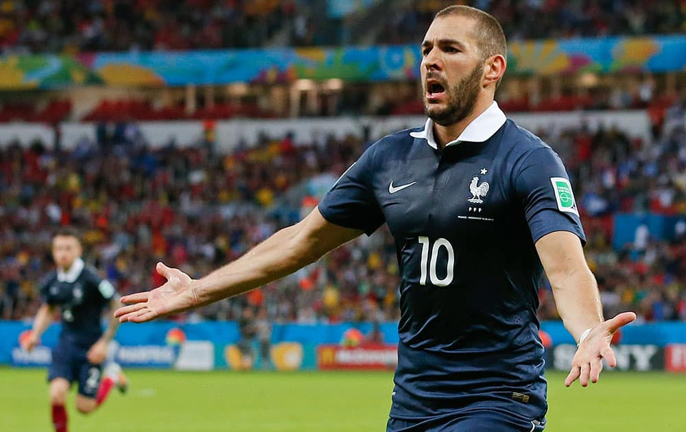 France's Karim Benzema celebrates after scoring his side's third goal during the group E World Cup soccer match between France and Honduras at the Estadio Beira-Rio in Porto Alegre, Brazil.
