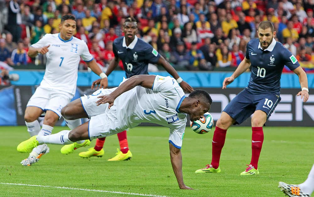 Honduras' Maynor Figueroa (3) tries to block the ball during the group E World Cup soccer match between France and Honduras at the Estadio Beira-Rio in Porto Alegre, Brazil.