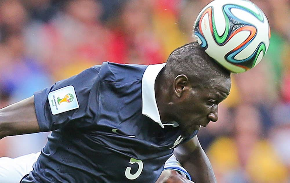 France's Mamadou Sakho heads the ball during the group E World Cup soccer match between France and Honduras at the Estadio Beira-Rio in Porto Alegre, Brazil.