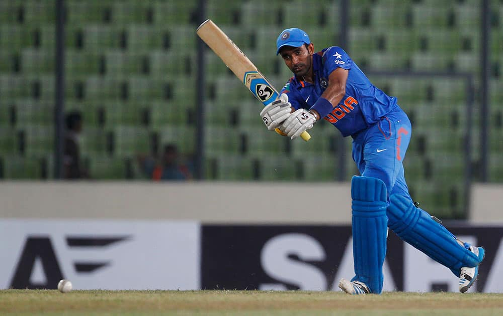 India's Robin Uthappa plays a shot during their first one-day International cricket match against Bangladesh in Dhaka, Bangladesh.