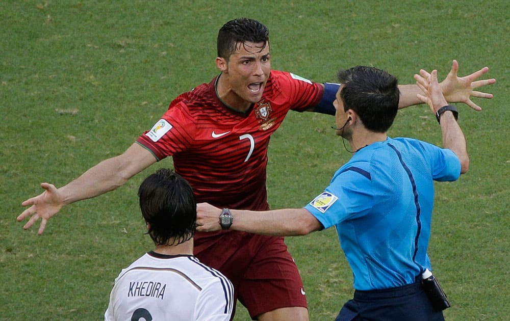 Portugal's Cristiano Ronaldo protests to referee Milorad Mazic from Serbia during the group G World Cup soccer match between Germany and Portugal at the Arena Fonte Nova in Salvador, Brazil.