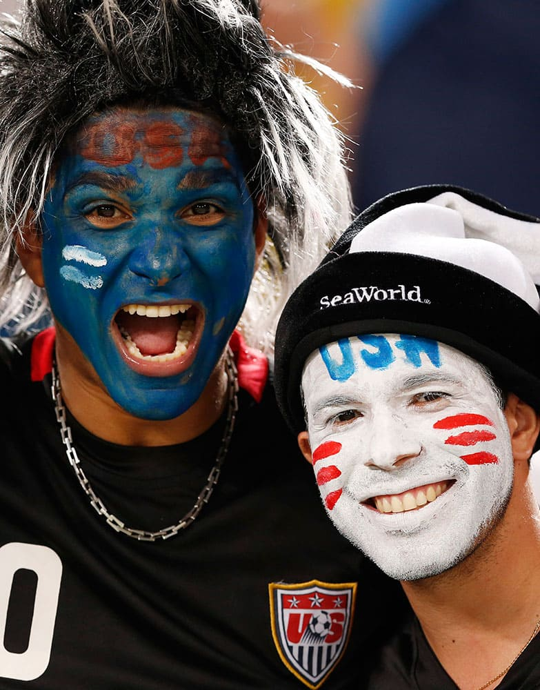 USA fans cheer before the group G World Cup soccer match between Ghana and the United States at the Arena das Dunas in Natal, Brazil.