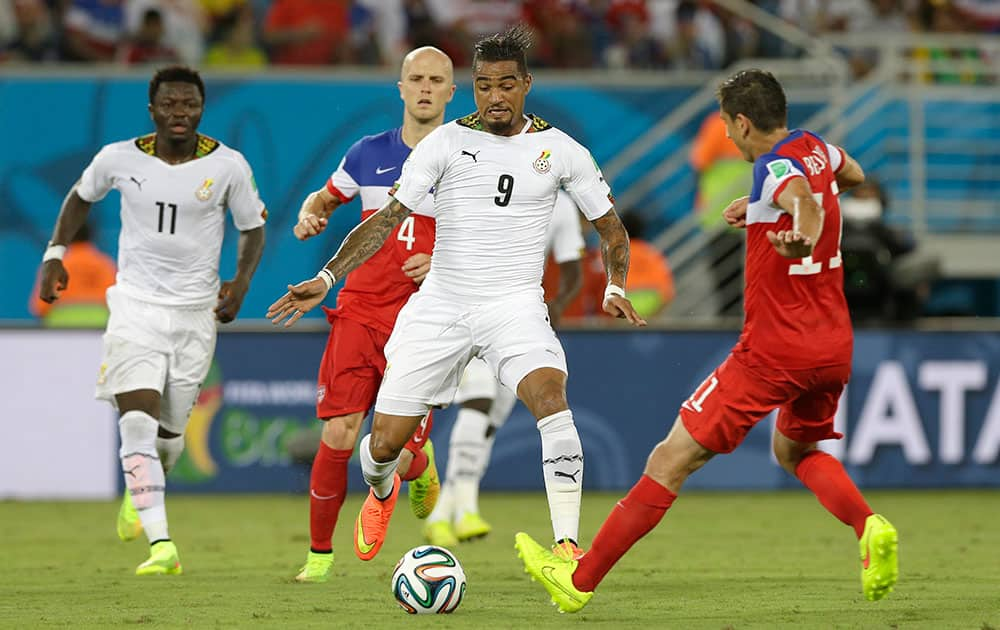 Ghana's Kevin-Prince Boateng runs with the ball during the group G World Cup soccer match between Ghana and the United States at the Arena das Dunas in Natal, Brazil.