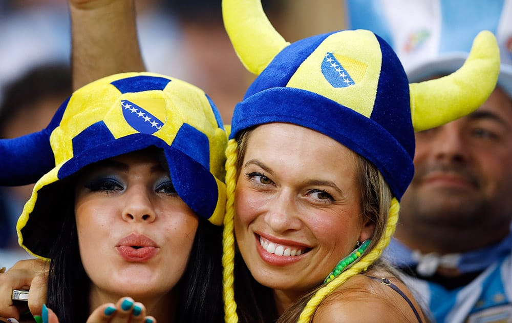 Fans pose before the start of the group F World Cup soccer match between Argentina and Bosnia at the Maracana Stadium in Rio de Janeiro, Brazil.