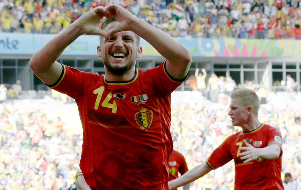 Belgium's Dries Mertens celebrates after scoring his side's second goal during the group H World Cup soccer match between Belgium and Algeria at the Mineirao Stadium in Belo Horizonte, Brazil.