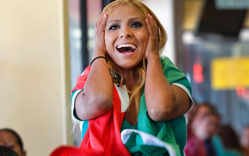 Mexican soccer fan Estela Rodriguez watches the telecast of the 2014 World Cup Brazil between Brazil vs Mexico in Huntington Park, Calif.