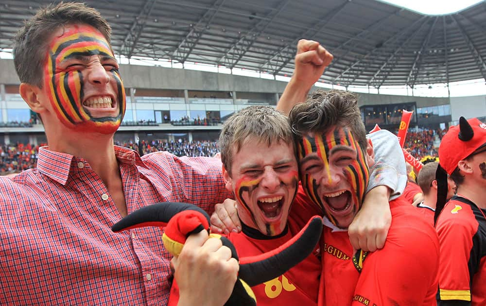 Fans of the Belgian national soccer team cheer during the match against Algeria, broadcast live on a giant video screen at the Ghelamco soccer stadium in Ghent, western Belgium.