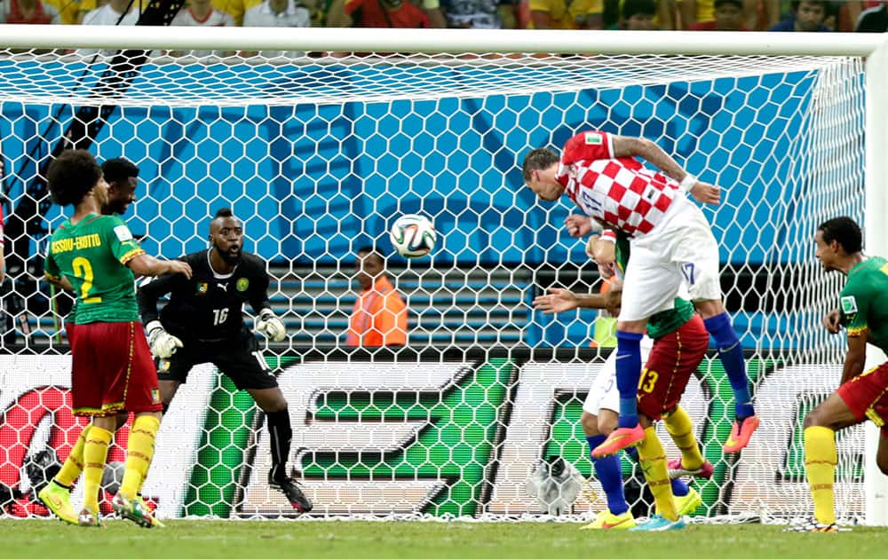 Croatia's Mario Mandzukic, second right, scores his side's third goal during the group A World Cup soccer match between Cameroon and Croatia at the Arena da Amazonia in Manaus, Brazil.