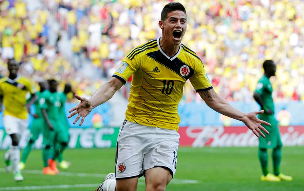 Colombia's James Rodriguez celebrates after scoring his side's first goal during the group C World Cup soccer match between Colombia and Ivory Coast at the Estadio Nacional in Brasilia.