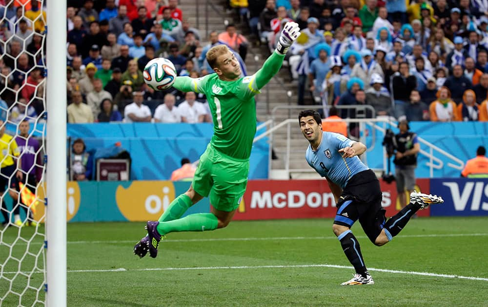 England's goalkeeper Joe Hart can't stop Uruguay's Luis Suarez's header to score his side's first goal during the group D World Cup soccer match between Uruguay and England at the Itaquerao Stadium in Sao Paulo.