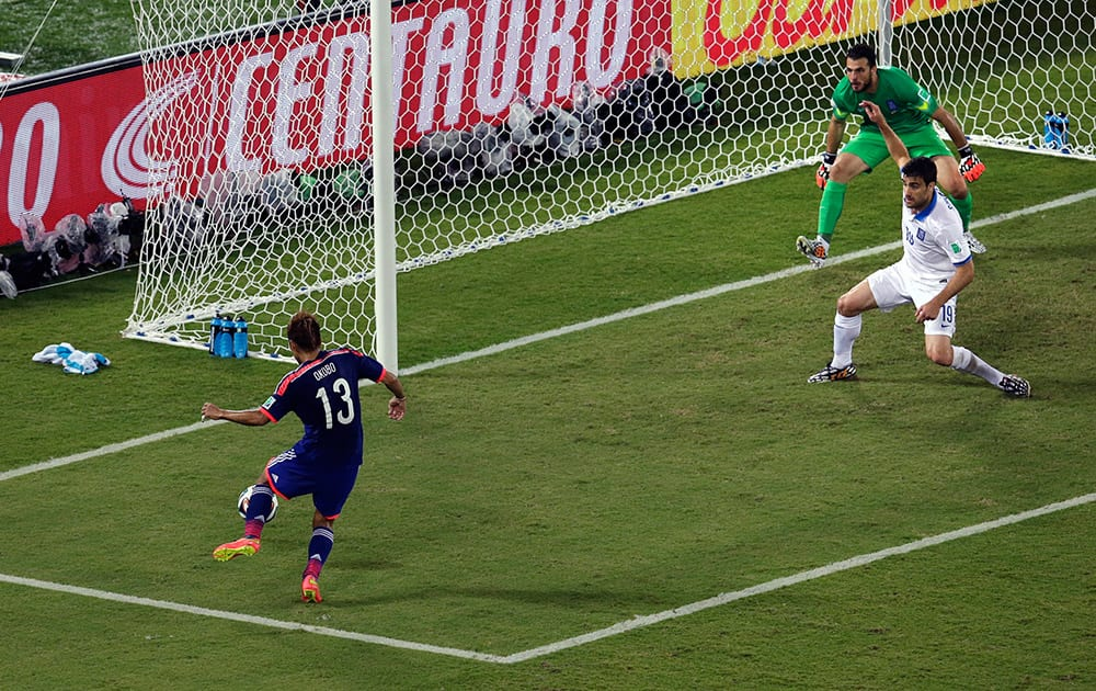 Japan's Yoshito Okubo fails to score during the group C World Cup soccer match between Japan and Greece at the Arena das Dunas in Natal, Brazil.