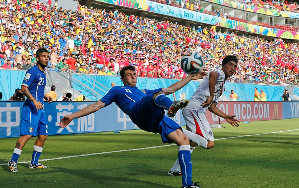 Italy's Matteo Darmian clear the ball during the group D World Cup soccer match between Italy and Costa Rica at the Arena Pernambuco in Recife, Brazil.