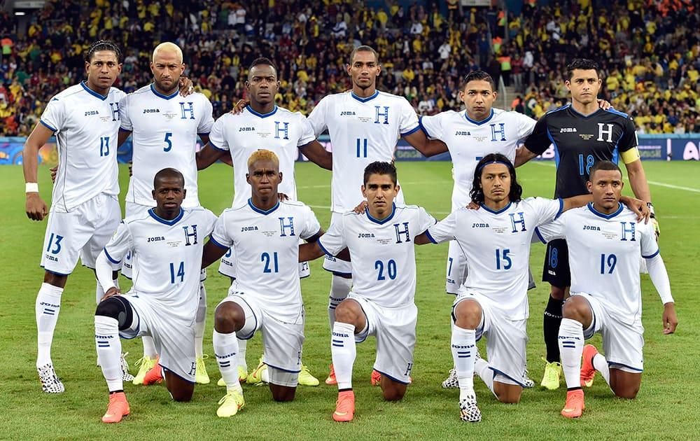 The Honduras team poses for a group photo before the group E World Cup soccer match between Honduras and Ecuador at the Arena da Baixada in Curitiba, Brazil.