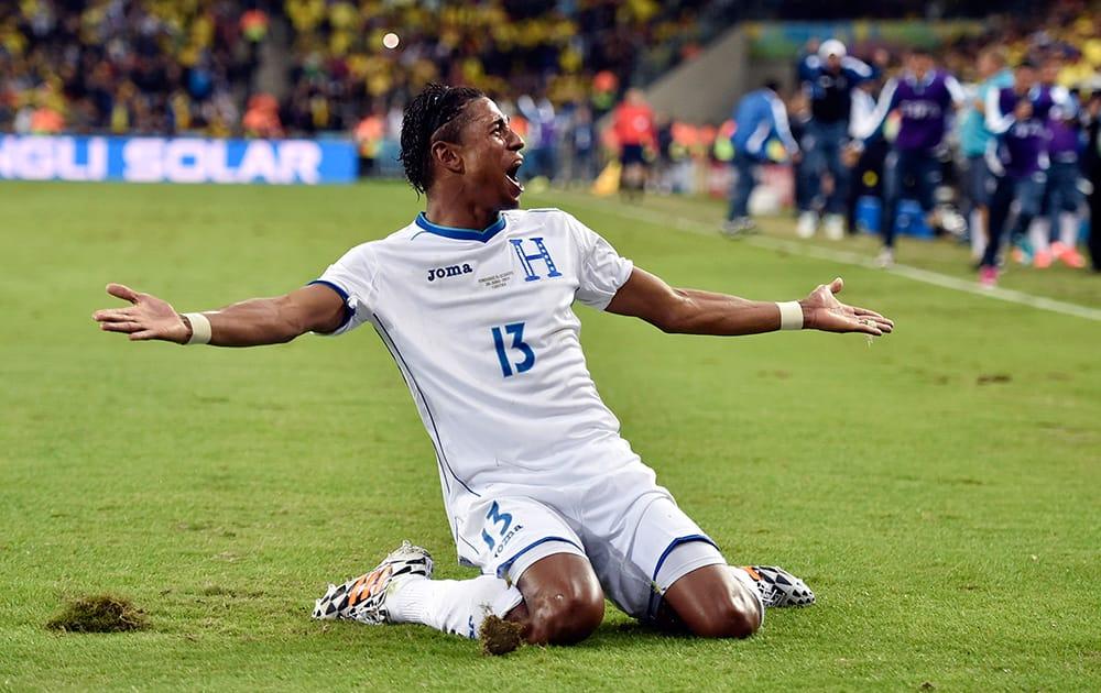 Honduras' Carlo Costly celebrates after scoring a goal during the group E World Cup soccer match between Honduras and Ecuador at the Arena da Baixada in Curitiba.