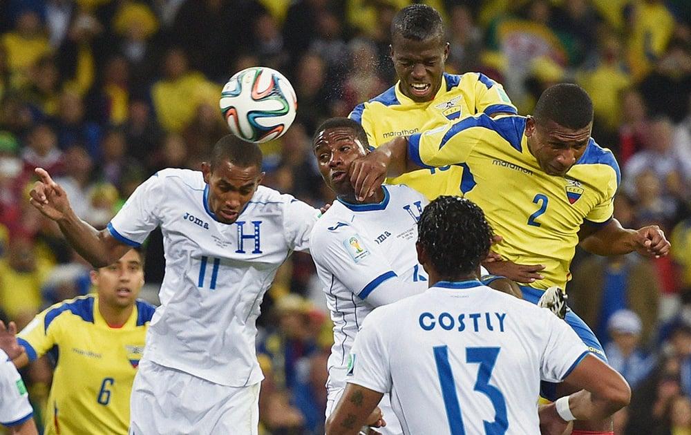 Ecuador's Enner Valencia, top right, scores his team's second goal during the group E World Cup soccer match between Honduras and Ecuador at the Arena da Baixada in Curitiba, Brazil.