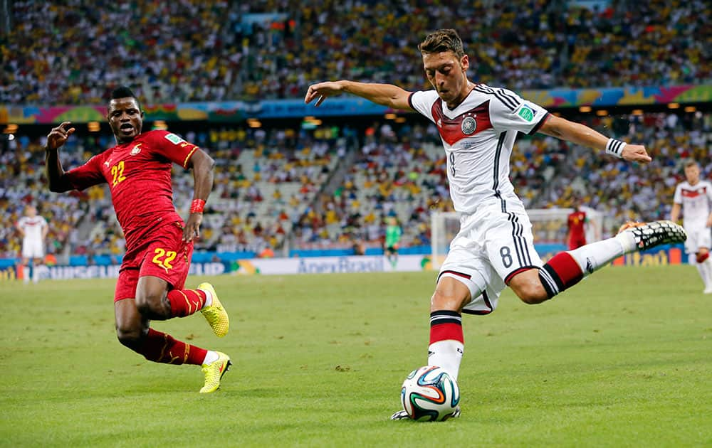 Germany's Mesut Ozil crosses the ball during the group G World Cup soccer match between Germany and Ghana at the Arena Castelao in Fortaleza, Brazil.