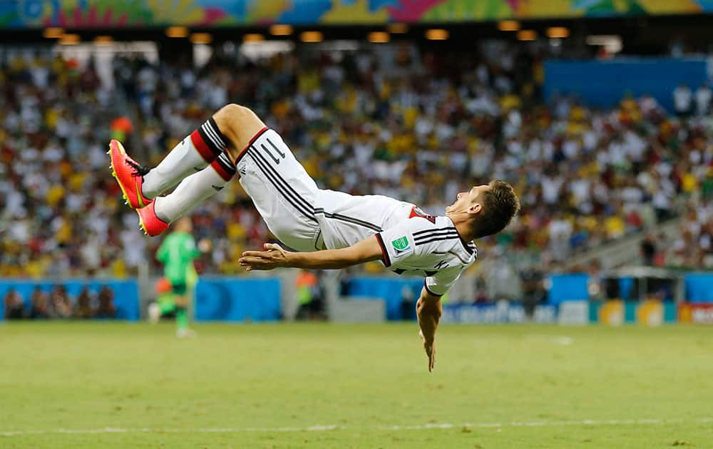 Germany's Miroslav Klose performs a flip as he celebrates after scoring his sides second goal during the group G World Cup soccer match between Germany and Ghana at the Arena Castelao in Fortaleza, Brazil.