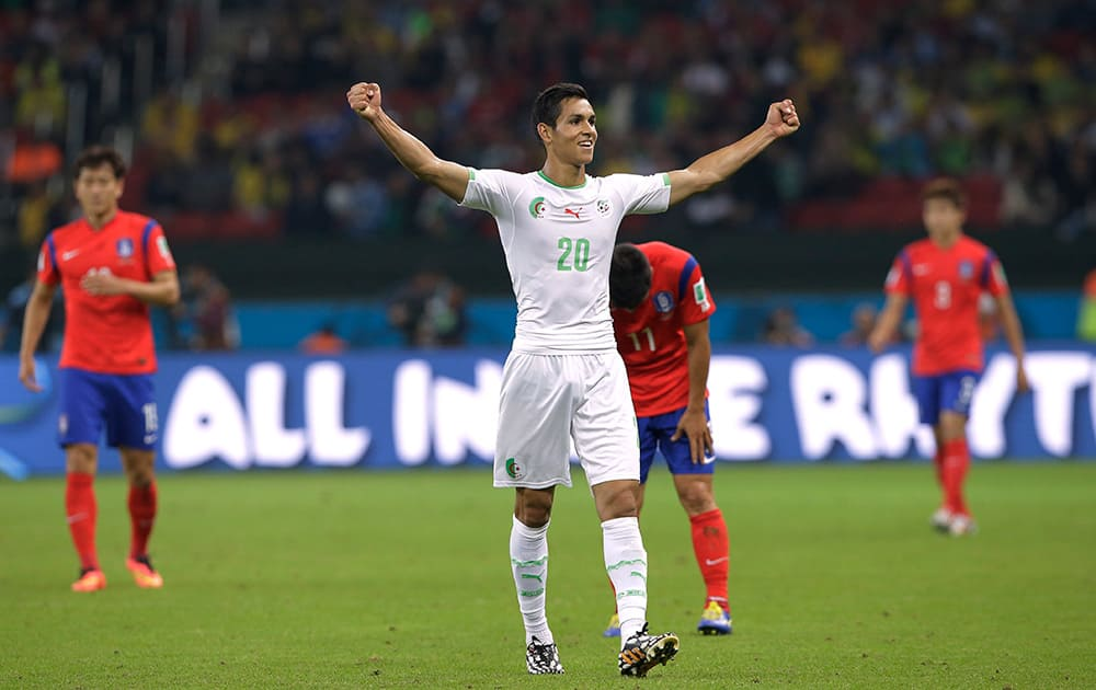 Algeria's Aissa Mandi celebrates after Algeria's 4-2 victory over South Korea during the group H World Cup soccer match between South Korea and Algeria at the Estadio Beira-Rio in Porto Alegre, Brazil.