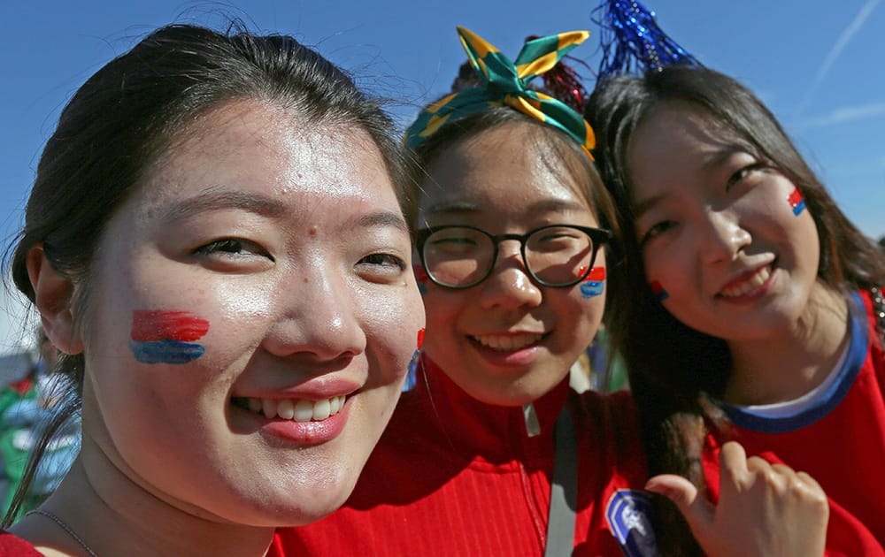 South Korean fans pose outside of Estadio Beira-Rio before the group H World Cup soccer match between South Korea and Algeria in Porto Alegre, Brazil.