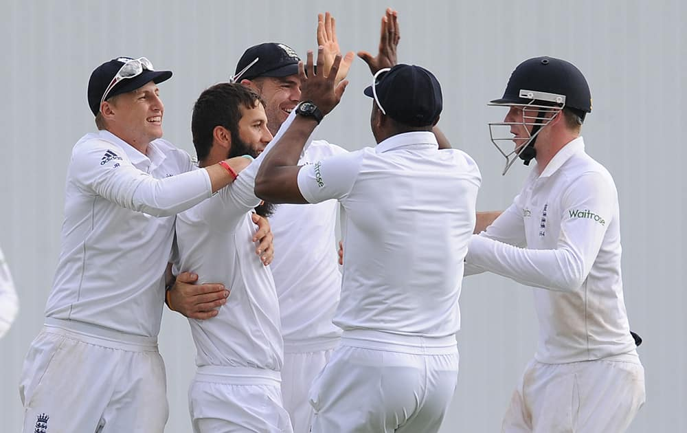 England's Moeen Ali celebrates with team mates after bowling Sri Lanka's Lahiru Thirimanne for a duck, during day three of the Second Test Match between England and Sri Lanka at Headingley cricket ground, Leeds, England.