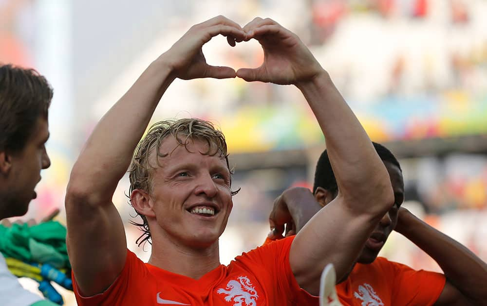 Netherlands' Dirk Kuyt forms a heart with his hands after the group B World Cup soccer match between the Netherlands and Chile at the Itaquerao Stadium in Sao Paulo, Brazil.