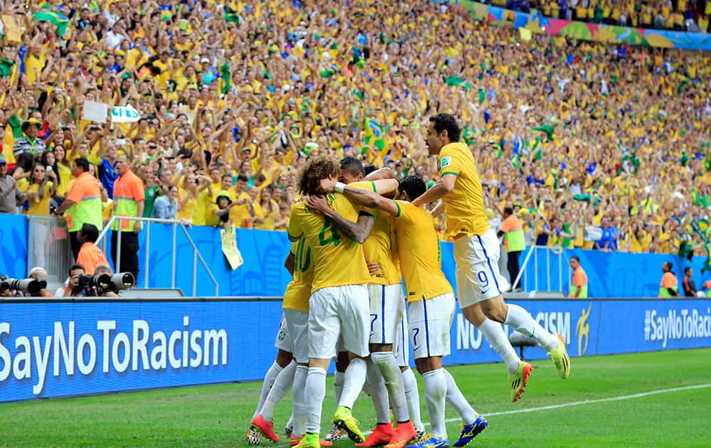 Brazil celebrate after Brazil's Neymar's first goal during the group A World Cup soccer match between Cameroon and Brazil at the Estadio Nacional in Brasilia, Brazil.