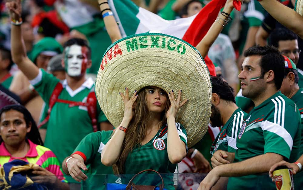 Mexico's fans celebrate after the group A World Cup soccer match between Croatia and Mexico at the Arena Pernambuco in Recife, Brazil.