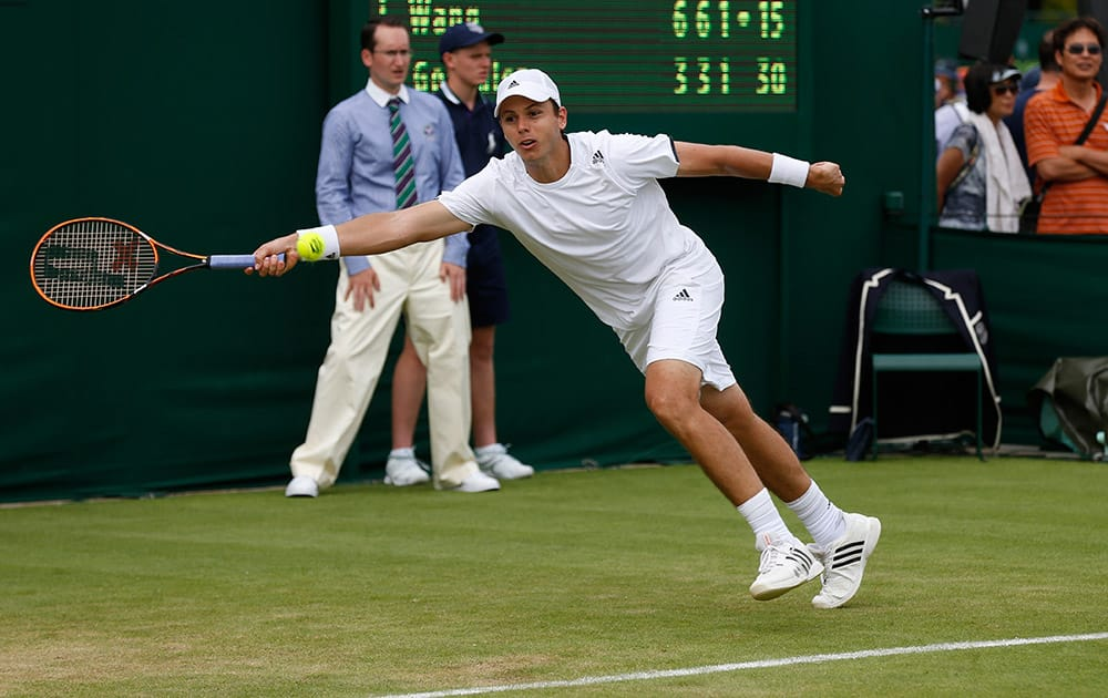Alejandro Gonzalez of Colombia returns against Jimmy Wang of Chinese Taipei during their first round match at the All England Lawn Tennis Championships in Wimbledon, London.