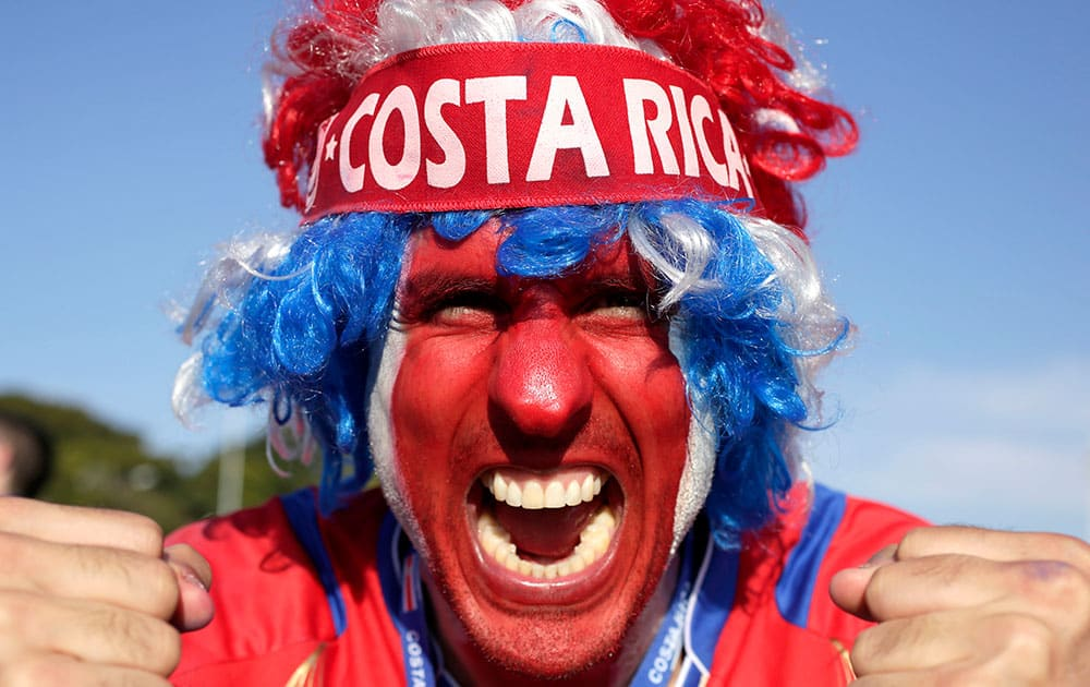 A supporter celebrates Costa Rica's classification at the end of the World Cup group D match against England, at the Mineirao Stadium, in Belo Horizonte, Brazil.