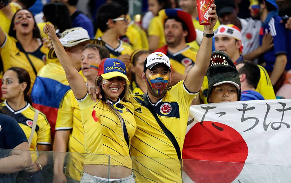 Colombia's fans celebrate after the group C World Cup soccer match between Japan and Colombia at the Arena Pantanal in Cuiaba, Brazil.