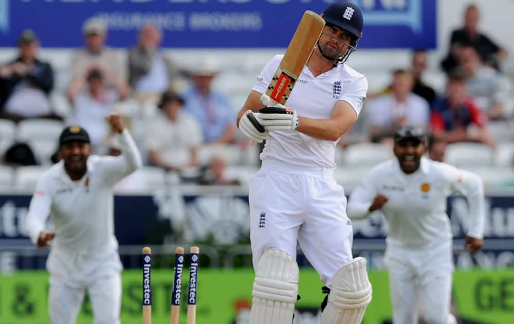 England's Alastair Cook is bowled by Sri Lanka's Dhammika Prasad for 16 runs during day four of the Second Test Match between England and Sri Lanka at Headingley cricket ground, Leeds, England.