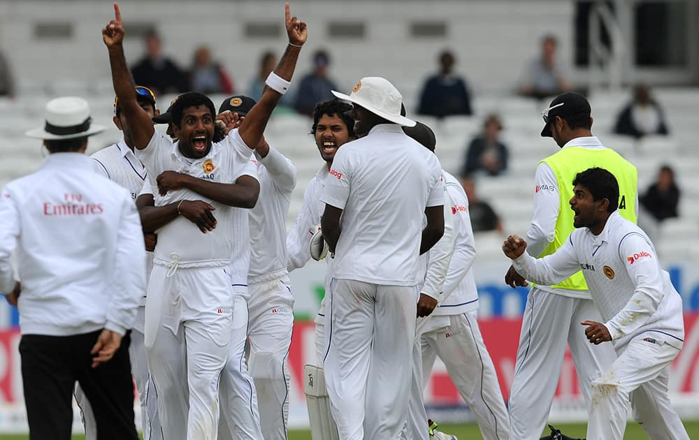 Sri Lanka's Dhammika Prasad celebrates after a review confirms he bowled England's Matt Prior, caught by Kaushal Silva for 10 runs, during day five of the Second Test Match between England and Sri Lanka at Headingley cricket ground, Leeds, England.