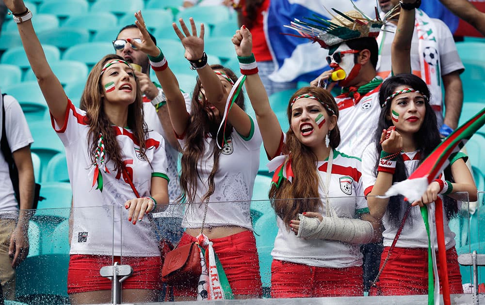 Iran's fans cheer for their team during the group F World Cup soccer match between Bosnia and Iran at the Arena Fonte Nova in Salvador, Brazil.
