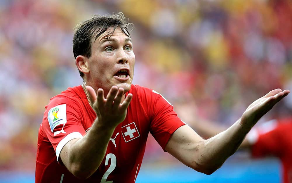 Switzerland's Stephan Lichtsteiner reacts during the group E World Cup soccer match between Honduras and Switzerland at the Arena da Amazonia in Manaus, Brazil.