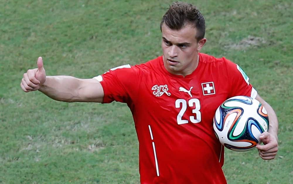 Switzerland's Xherdan Shaqiri reacts after Switzerland defeated Honduras, 3-0, during the group E World Cup soccer match between Honduras and Switzerland at the Arena da Amazonia in Manaus, Brazil.