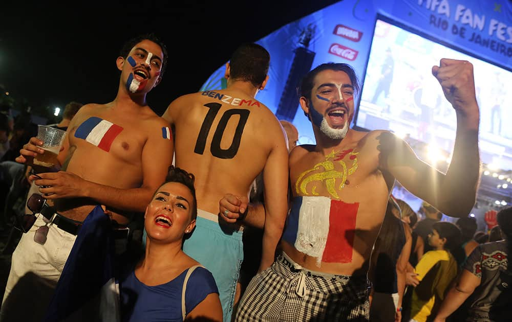 French soccer fans pose for photos after watching a live telecast of the World Cup group E match between France and Ecuador inside the FIFA Fan Fest area on Copacabana beach, in Rio de Janeiro, Brazil.