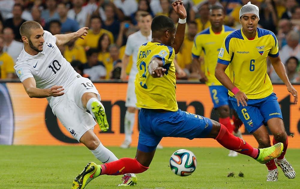 Ecuador's Frickson Erazo, front, blocks a shot by France's Karim Benzema, left, during the group E World Cup soccer match between Ecuador and France at the Maracana stadium in Rio de Janeiro, Brazil.