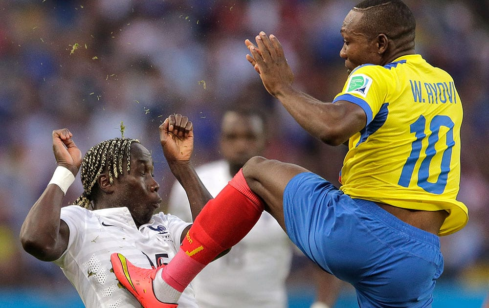 France's Bacary Sagna ends up with Ecuador's Walter Ayovi's cleats in his chest after he kicked the ball away during the group E World Cup soccer match between Ecuador and France at the Maracana Stadium in Rio de Janeiro, Brazil.