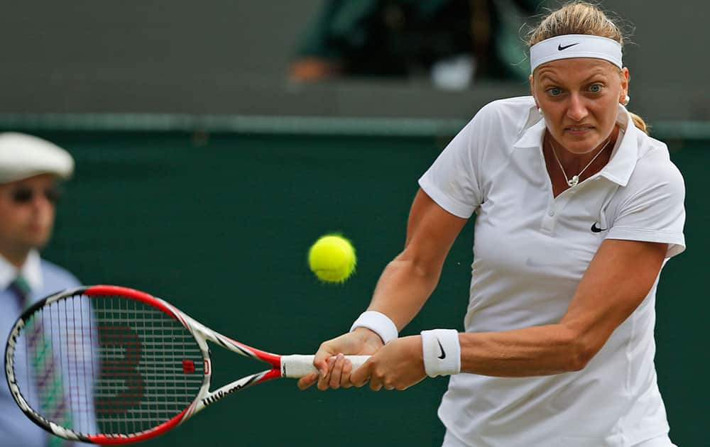 Petra Kvitova of the Czech Republic returns to Mona Barthel of Germany during their women's singles match at the All England Lawn Tennis Championships in Wimbledon.