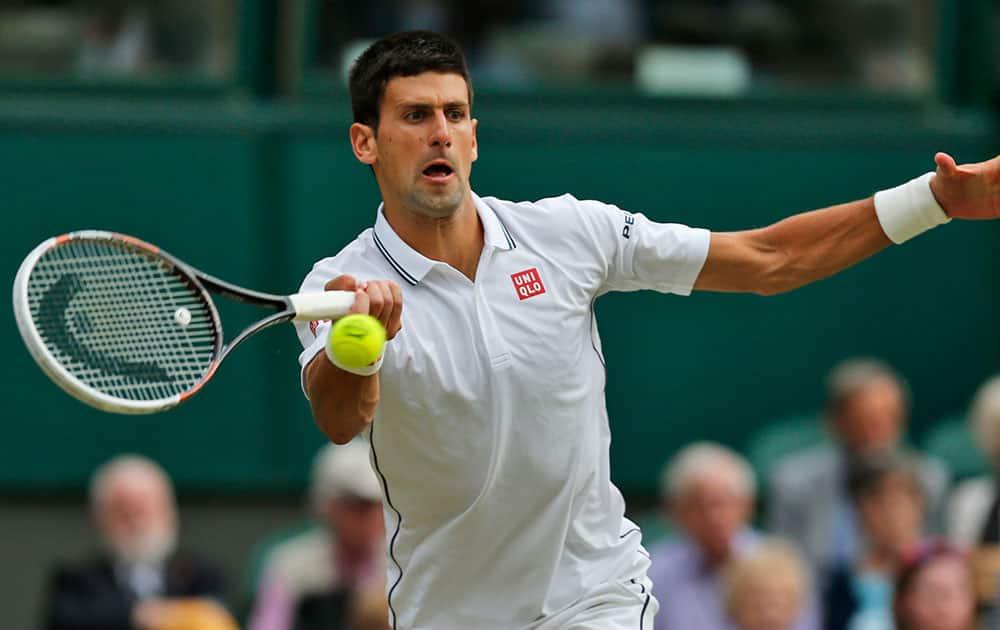 Novak Djokovic of Serbia returns to Radek Stepanek of Czech Republic during their men's singles match at the All England Lawn Tennis Championships in Wimbledon.