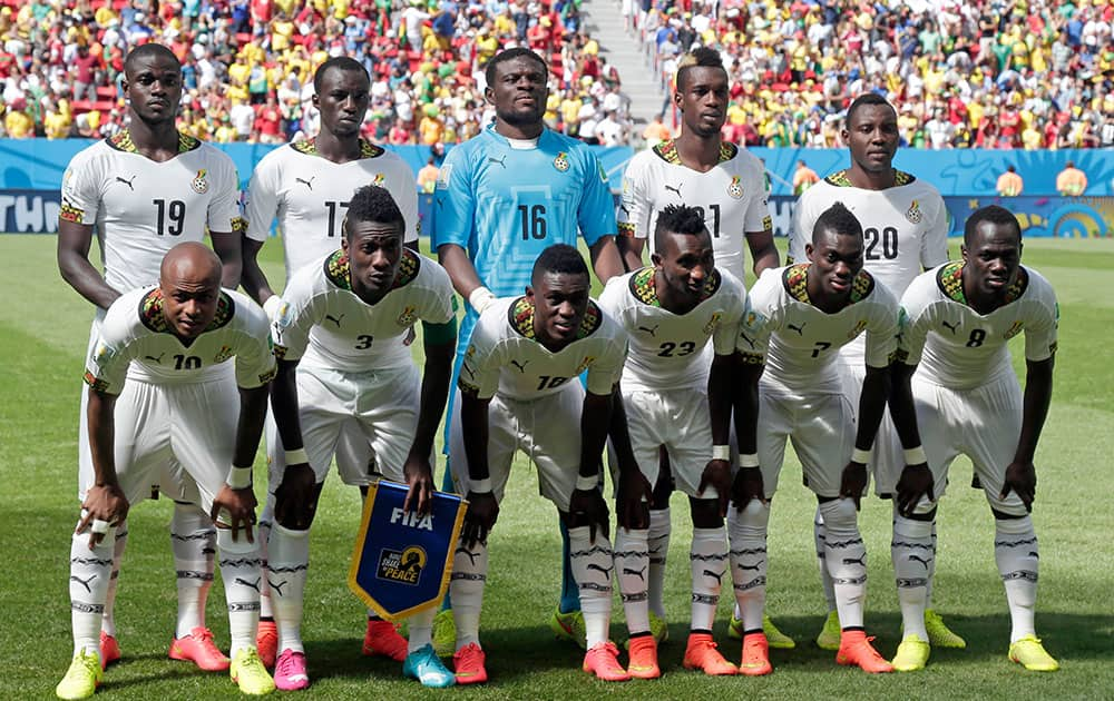 Ghana's players pose for photos during the group G World Cup soccer match between Portugal and Ghana at the Estadio Nacional in Brasilia, Brazil.