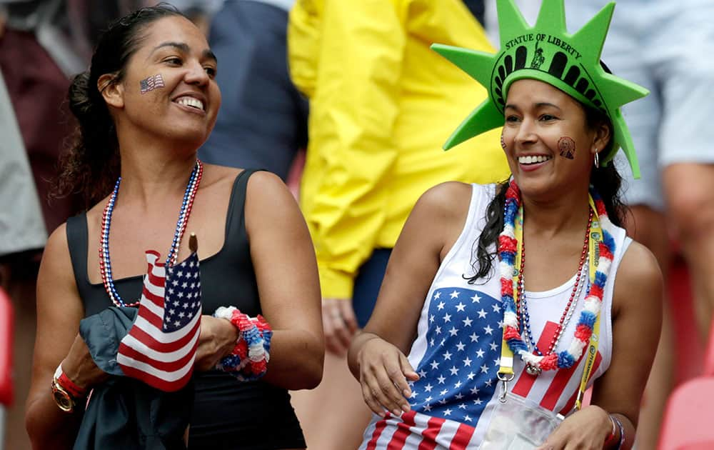 USA supporters celebrate after the national team qualified for the next World Cup round following their 1-0 loss to Germany during the group G World Cup soccer match between the USA and Germany at the Arena Pernambuco in Recife, Brazil.