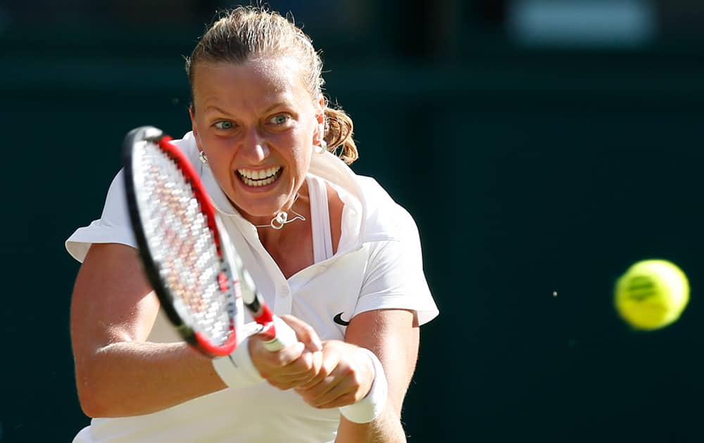 Petra Kvitova of the Czech Republic returns to Venus Williams of U.S. during their women's singles match at the All England Lawn Tennis Championships in Wimbledon, London.
